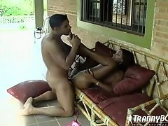 The arousing shemale sex scene outdoors features a babe in a bikini and her man. They kiss a...
