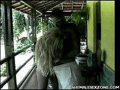 The Brazilian shemale and her man spend their video fooling around on the porch and it looks...