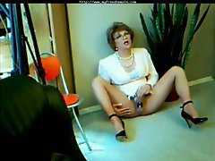 The amateur milf shemale is dressed for success like an office babe and she masturbates in t...