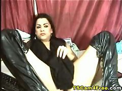 Amateur in leather boots strokes