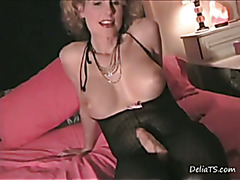 I get Delia all worked up talking dirty to her while she strokes her rigid clitty wearing a ...