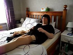The crossdresser in a peignoir and stockings show his nylon fetish in the webcam video. The ...