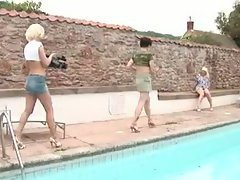 The tranny and her two blonde lady friends fool around outdoors and everyone has fun with th...