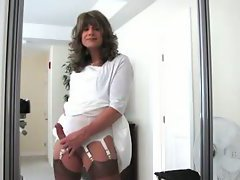 We're in her bedroom and the pretty brunette TV looks lovely in her white dress and tan stoc...