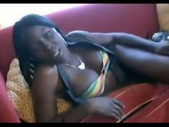 A statuesque black shemale sits on the couch and entertains us in her arousing video with ho...