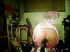 Wearing pink fishnet pantyhose and stockings, pink garter belt, pink panties, pink naughty s...