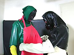 Rubber countrywoman Leila wears now a red rubber apron. She is angry because the rubber slut...