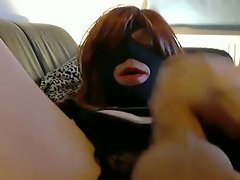When the crossdresser spreads his stocking clad legs we see his masked face, his red hair, a...