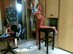 The tanned blonde amateur tranny in a blue and white striped bikini loves a good anal fuck a...