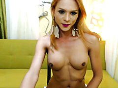 This exotic looking shemale babe teases her viewers by slowly stripping her clothes off. She...