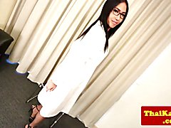 Asian shemale doctor with glasses strips sensually than tugs her dick