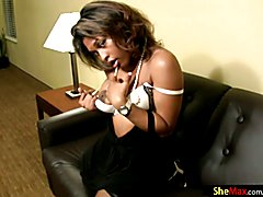 This ebony shebabe set her big titties free, squeezing them and fondling her big, dark nippl...