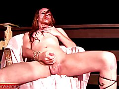 Pretty redhair shemale wants to be a stripper. She gets into her dance and decides to add oi...