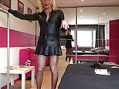 i am your dream sophisticated lady with stocking leather skirt heels and chastited