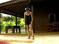 Exotic looking tranny Lohane Silva was working on tanning her already dark skin and playing ...
