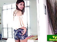 Young ladyboy stimulates ass with toy after striptease