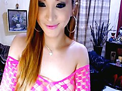 Watch this beautiful asian shemale as she gradually undress her clothes while massaging her ...