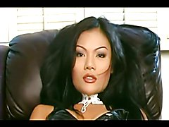 PVC and glove wearing ladyboy sucks and fucks