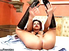 Nasty red haired tranny Francini Munhoz enjoys to pour oil on her massive tits and rub it up...