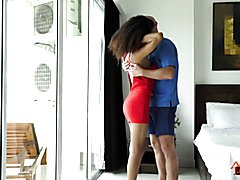 Cute curly-haired Ladyboy Island and her man are kissing in their hotel bedroom. He pushes ...