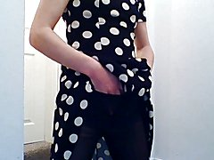 Crossdresser masturbating in a black and white spotted dress with black, lacey lingerie and ...