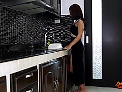 Cute Ladyboy Nanny, dressed in a sexy black dress, is in the kitchen when her lover arrives....