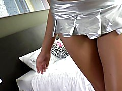 Busty Thai ladyboy Pinky teases the camera, stroking the big bulge swelling inside the sheer...