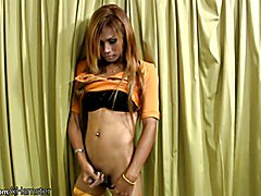 With her red hair and outfit Tay looks fantastic. She pulls out her hard juicy banana cock b...