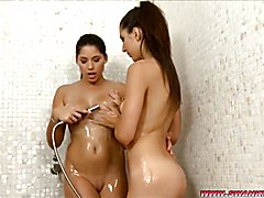 Watch Bettina Lacza and Melinda as they lick and suck each other in the warm, steamy shower!