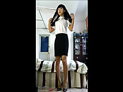 Sexy Ladyboy loves to dress up and play with a dildo