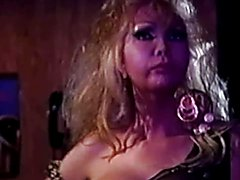 Hot 80s queen Coco gets strip instructions from Sulka and has a hot encounter with the barma...