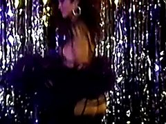 Eighties shemale bombshell Julie Bond does a strip-dance and then a mutual suck with a young...