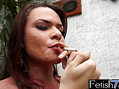 Sexy and alluring ts babe Lara Machado burning up her ciggs teasingly while erotically movin...