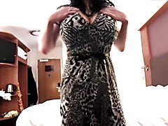 Leopard print dress, white bra and pink thong all for your enjoyment.