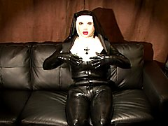 The masked doll rubber nun unzips her latex catsuit to reveal her silicone body and then mas...
