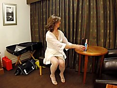 Lovely lady having fun in a hotel room. Who is she?