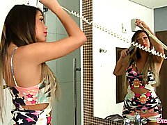 Horny tranny combs her hair and the gets naked and take her dick in hand She plays with her ...