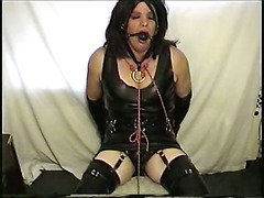 Little Miss Christi wearing tight latex rubber corsette, leggings and inserted butt plug is ...