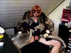 Redhead shemale slut in fur