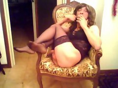 The guy in stockings and lingerie smokes and masturbates his cock. He performs on webcam and...