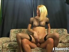 The insanely hot shemale in the black fishnets has a banging body and gets banged on the cou...