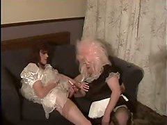 The amateur sissies in their frilly dresses and wigs film it as they hang out on the couch a...