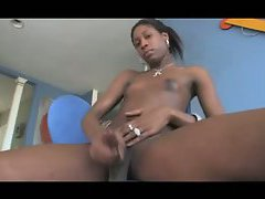 Skinny black tranny cums hard