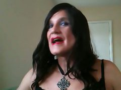 The black lingerie on the crossdresser includes black satin gloves and he looks hot as he pl...