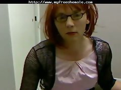 The redhead in glasses and office clothes plays on webcam and spends plenty of time masturba...