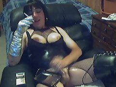 The amateur is in a full on leather outfit with boots and fishnets and tit inserts to look m...