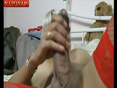 The big cock blonde tranny is ready to fuck! She holds the camera and films her man sitting ...
