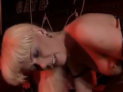 The shaved head girl and sexy blonde shemale in latex fuck in the dungeon and it's hot shit....