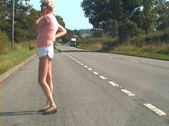 Pretty Crossdresser flashing her cock on busy road.