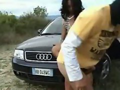 The shemale stands near the Audi looking like the hottest piece of ass in the business. She ...